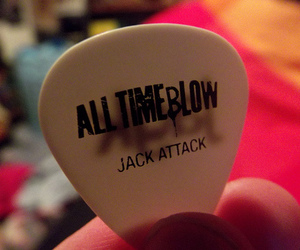all time low and guitar pick image