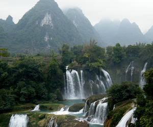 waterfall and mountains image