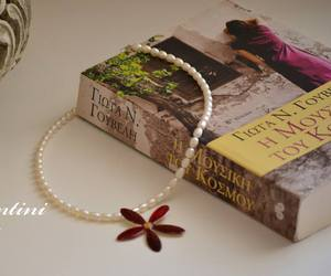 book, necklace, and pearls image