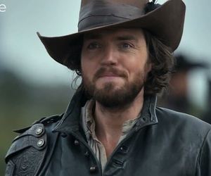 athos, tom burke, and the musketeers image