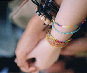 bracelets, color, and hand holding image