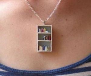 book, necklace, and bookshelf image