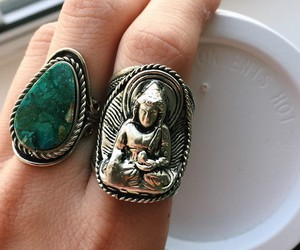 Buddha, rings, and green image