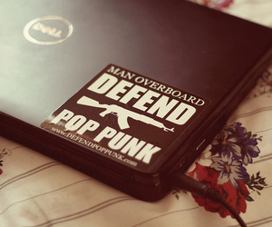 bed sheet, laptop, and man overboard image