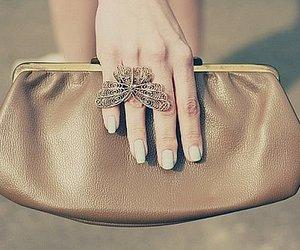A girl, bag, and nail image