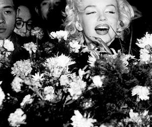 Marilyn Monroe and flowers image