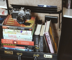 books, briefcase, and camera image