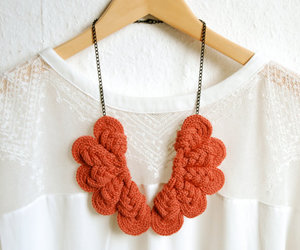 coral, jewelry, and knitted image