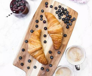blueberries, coffee, and croissants image