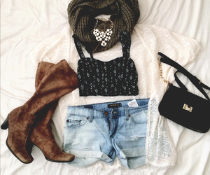 black purse, brown boots, and denim image