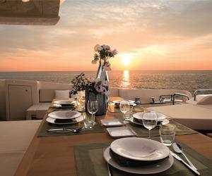 sunset, dinner, and luxury image