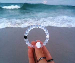 beach, bracelets, and sand image