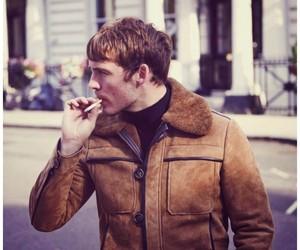 sam claflin and cigarette image