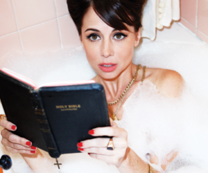 bathtub, brunette, and red nails image