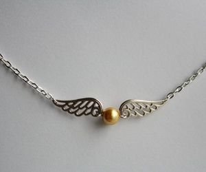 golden snitch, harry potter, and pomo de ouro image