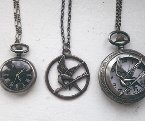clock, hipster, and mockingjay image