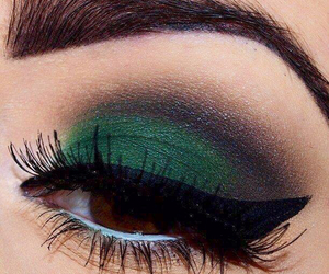 green makeup and dramatic look image