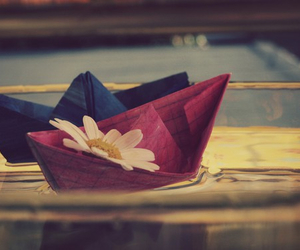 flowers, boat, and water image