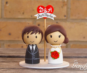 bride, groom, and cake topper image
