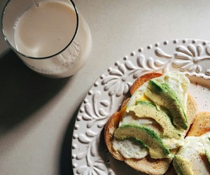 almond milk, fried eggs, and glass of milk image