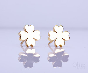 gold stud earrings, gold clover earrings, and silver stud earrings image