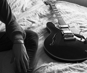 bed, black and white, and guitar image