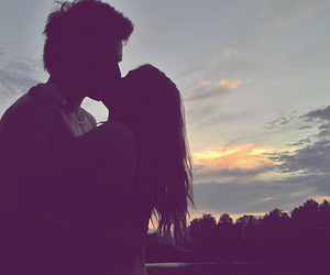 couple, kiss, and sunset image