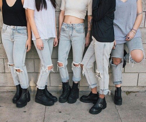 black boots and ripped jeans image