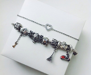 bracelets, chains, and charms image