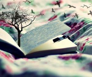 book, tree, and bird image