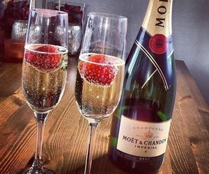 champagne, strawberry, and moet image