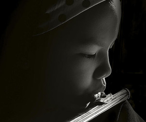 black & white, child, and flute image