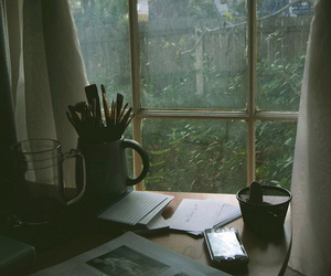 books, desk, and papers image