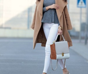 white jeans, grey sweather, and sand coat image
