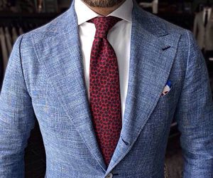 blue jacket, pocket square, and spotted tie image