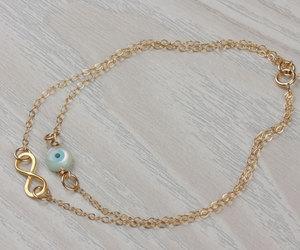 evil eye bracelet, silver infinity bracelet, and gold evil eye bracelet image
