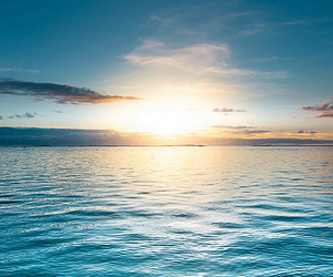 sun, sky, and water image