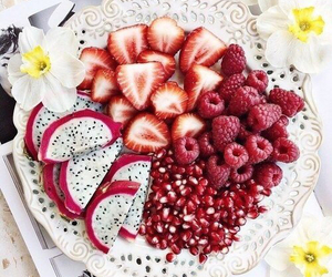 pomegranate, raspberries, and strawberries image