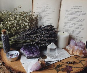 book, crystal, and flowers image