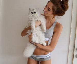 animal, brunette, and Calvin Klein image