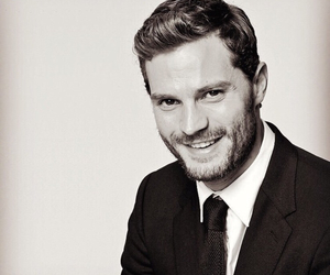 Jamie Dornan, christian grey, and smile image