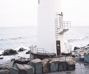 white, sea, and lighthouse image