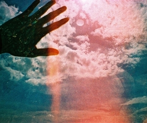 hand, sky, and clouds image