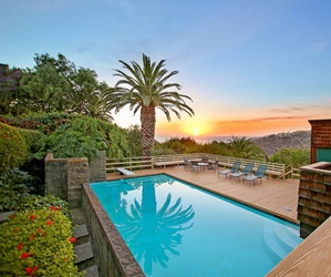 mansion, palm trees, and pool image