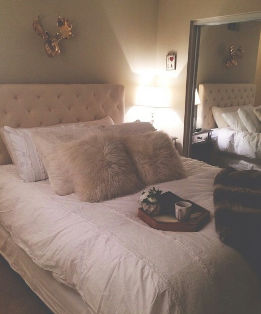 Gold Wall Decor White Bed Frame White Blanket Furry Pillows Tray On Bed Floor Mirrors White Bedroom