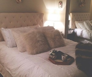 white bedroom, white blanket, and furry pillows image