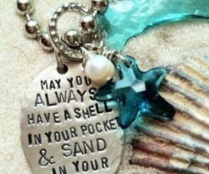 shell, sand, and sea image