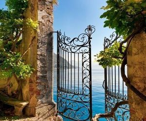 sea, italy, and gate image