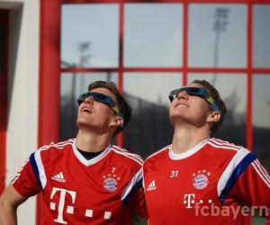 german, sun, and bastian schweinsteiger image
