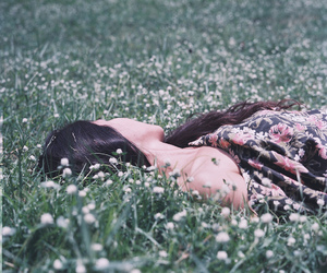 flowers, grass, and lying down image